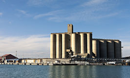 Industrial port with storage silos Stock Photos