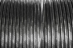 Industrial power electric cable, background. The electric cable reeled up on the coil, can be used as a background Royalty Free Stock Photography