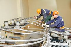 Industrial power electricians at work Stock Image