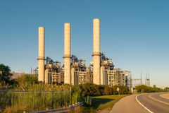 Industrial power generation facility at sunset stock photography