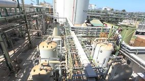 Industrial power plant, pipeline with blue sky stock video footage