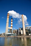 Industrial power plant with smokestack Royalty Free Stock Image
