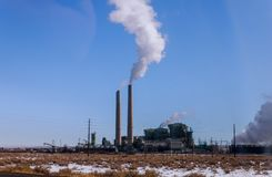 Industrial power plant with smokestack. Steaming cooling towers in blue sky nuclear atomic danger industry station environmental electricity energy pollution royalty free stock photos