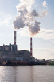 Industrial power plant. With two smokestack on the river Stock Image