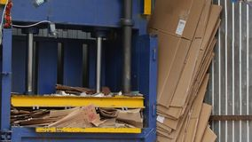 Industrial press- recycling of cardboard at industrial landfill stock footage