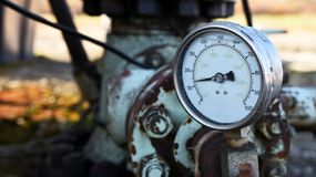 Industrial Pressure Gauge Close Up. A close up image of an old industrial pressure gauge royalty free stock image