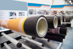 Industrial printshop: Flexo press printing. UV flexo press for printing packaging. Flexography (also called surface printing), often abbreviated to flexo, is a royalty free stock photo