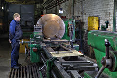 Industrial processing of metal on big turning lathe machine Stock Image