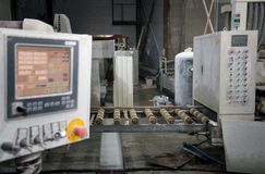 Industrial processing of natural stone. Dashboard in production royalty free stock image
