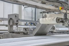 Machinery production cutting large quantities of meat Stock Photo