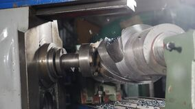 Industrial production, locksmith industry concept. Sparks from grinding wheel in slow motion. Metal grinding machine
