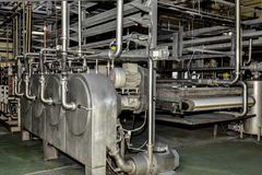 Industrial production of potato starch. Processing plant stock images