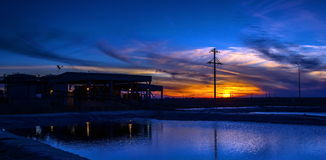 Industrial production at sunset. In the desert Betpakdala, South Kazakhstan royalty free stock image