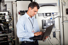 Industrial programmer checking machine royalty free stock photography