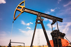 Industrial pump jack at oil and gas field Royalty Free Stock Photo