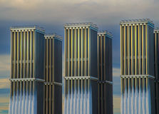 Industrial radiators. Towards blue sky and clouds royalty free stock photo
