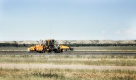 Industrial railroad equipment. Railroad repair equipment on a railway in a Montana countryside landscape stock photography