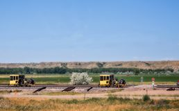 Industrial railroad repair equipment. Railroad repair equipment on a railway in a Montana countryside landscape royalty free stock photos