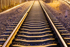 Industrial railway track in daytime Royalty Free Stock Photos