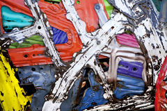 Industrial Recycled Metal Background. A background made from colorful recycled scrap metal Stock Image