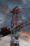 Industrial red crane, sunset background Royalty Free Stock Photography