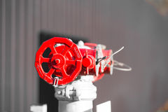 Industrial red valve on pipeline pump outdoor Stock Photos