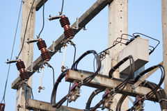 Industrial reduces power station. Power transformer on ceramic and porcelain insulators wire line Royalty Free Stock Photos