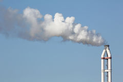Industrial refinery plant with smokestack Stock Photos