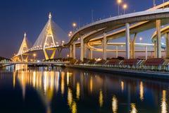 Industrial Ring Road Suspension Bridge crosses main river in Bangkok Thailand Stock Photo