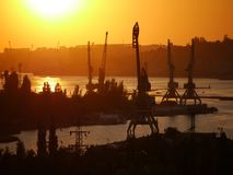Industrial river port landscape with cranes on a river Stock Photo
