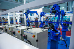 Industrial robot for arc welding. Liuzhou,China,November 2013:Robot Optimized for Arc Welding that made by Shanghai Yaskawa Shougang Robot Co.,LTD working at Royalty Free Stock Images