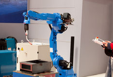 Industrial robot arm. Used for welding Stock Photo