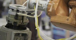 Industrial Robot arm active in factory. Automation welding mechanical procedure stock video