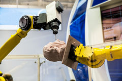 Industrial robot close up process of wooden processing Stock Image