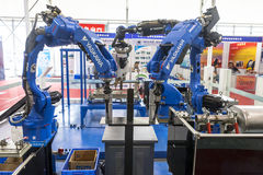Industrial Robot For Arc Welding Royalty Free Stock Photo