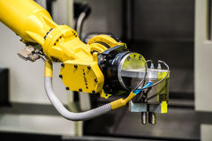 Industrial robot machine. Industrial robot with CNC machine. Metal processing industry Stock Image