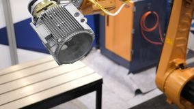 Industrial robot manipulator movements that are programmed in the control unit. Robot mechanism works in the factory