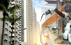 Industrial robot mechanical arm of working in the city. Industrial robot 4.0 mechanical arm of working in the city royalty free stock image