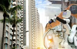 Industrial robot mechanical arm of working in the city. Industrial robot 4.0 mechanical arm of working in the city royalty free stock photos