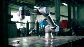 Industrial robot is moving while being attached to the table