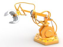 Industrial robot. Is operating.  grabs for something Royalty Free Stock Photo