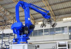 Industry 4.0 concept, Robot picking for smart warehouse in production line manufacturer factory. Industrial robot is picking product and place into pallet for royalty free stock photo