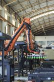 Industry 4.0 concept, Robot picking for smart warehouse in production line manufacturer factory. Industrial robot is picking product and place into pallet for stock photo