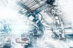 An industrial robot in a workshop. Industrial robot, Production workshop, artificial intelligence Royalty Free Stock Photo