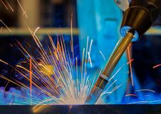 Industrial robot is welding assembly automotive part in car factory. Industrial robot is welding car part in automotive industrial factory Stock Photo