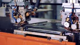 Industrial robotic equipment welding metal parts. stock video footage