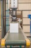 Industrial robot working in plastic factory Stock Image