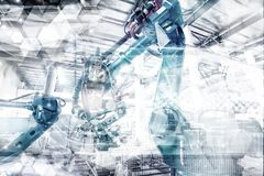 An industrial robot in a workshop. Industrial robot, Production workshop, artificial intelligence Royalty Free Stock Image