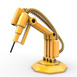Industrial robot. A yellow industrial robot is operating Stock Image