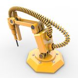 Industrial robot. A yellow industrial robot is operating Royalty Free Stock Photos